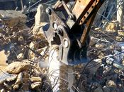 October 13, 2008: An excavator demolishes what remains of a structural column below street level.