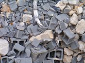 November 2, 2008: Debris, comprised mostly of broken cinderblocks at this location, lays on the ground.