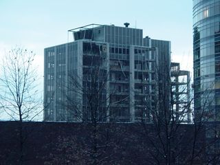 In a January 20, 2005 file photo taken from nearby Rosslyn Center, demolition is underway as removal of the exterior curtain wall is underway.
