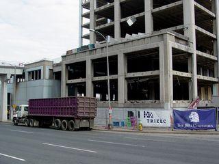Parked adjacent to the work site along Lynn Street, a truck waits.