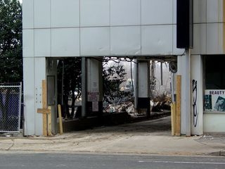 The entrance to the building's parking garage remains intact - for now.