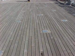 What are these strange square features on the deck back here? Turns out the squares are meant to be removed for use, concealing tie-downs for various items.