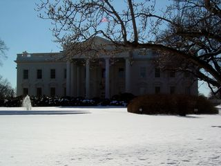 Interestingly enough, the snow was so bright as to cause the White House to appear dark by comparison!