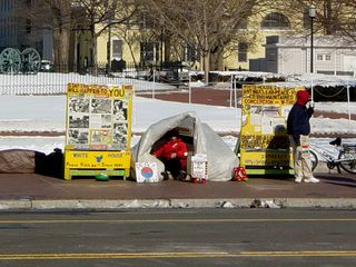 In a stationary position across the street, is an anti-nuclear peace vigil, having been going on for 24 hours a day since 1981.