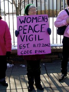 On the sidewalk immediately next to the White House fence, a group of women organized under the name Code Pink was protesting the then-upcoming war with Iraq.