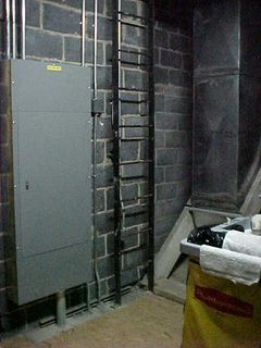Inside a utility closet, a ladder awaits, leading up to a catwalk above the top floor of Wilson Hall...
